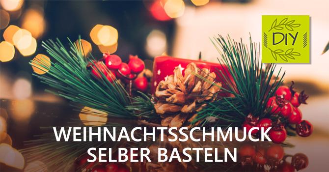 Weihnachtsschmuck aus Tanne, Zapfen und Hagebutten